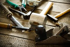 Many old working tools ( hammer, pliers, plane and Royalty Free Stock Images