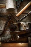 Many old working tools ( hammer, pliers, plane and Stock Photos