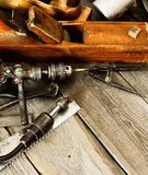 Many old working tools (plane, drill, mallet and Stock Images