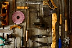 Many old working tools ( plane, saw and others) on Royalty Free Stock Photography