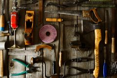 Many old working tools ( plane, saw and others) on Royalty Free Stock Image
