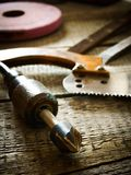 Many old working tools ( saw, plane and others) on Royalty Free Stock Image