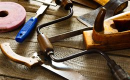 Many old working tools ( saw, plane and others) on Royalty Free Stock Photos