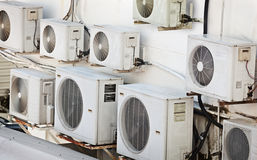 Many older air conditioners on the wall Royalty Free Stock Photos