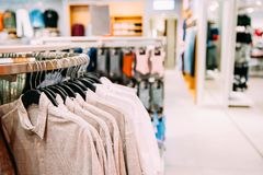 Many One-colour Polo Shirt On Hanger In Store Of Shopping Center.  Royalty Free Stock Photos
