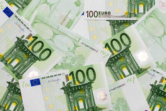 Many of one hundred euro banknotes lie side by side. Concept for wealth and investment Royalty Free Stock Photos