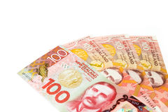 Many of one hundred New Zealand dallar banknotes as money backgr. New Zealand currency, Many of one hundred New Zealand dallar banknotes  on white background Stock Photos