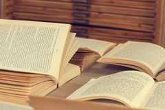 Open books on a wooden desk. Many open books on a wooden desk Stock Photos