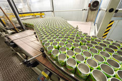 Many open green cans move on conveyor in Ochakovo Royalty Free Stock Images