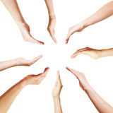 Many open hands in a circle Stock Photo