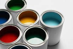 Many open paint cans on white. Background royalty free stock photography