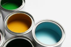 Many open paint cans on white. Background stock image