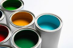 Many open paint cans on white. Background royalty free stock photo