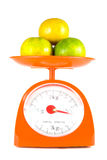 Many orange. Lying on weight scale Royalty Free Stock Photography