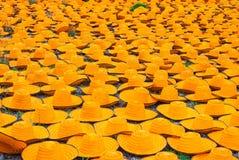 Many Orange Bamboo Farmer Hats on Ground Royalty Free Stock Image