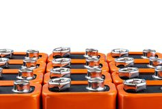 Many orange batteries, stand in several rows. Isolated on white background. Full depth of field royalty free stock image