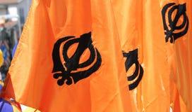 Orange flags with khanda symbol. Many orange flags with khanda symbol of sikhism Royalty Free Stock Image