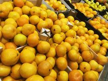 Many orange fresh fruits mandarins lying in boxes in supermarket Royalty Free Stock Photos