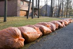 Many orange garbage bags at curb Royalty Free Stock Photo