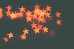 Many orange stars on a dark background. Stock Images