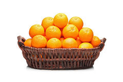 Many oranges in a basket royalty free stock photos