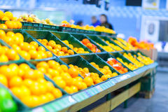 Many oranges on counter in the store Stock Photography