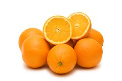 Many oranges isolated. On the white background Stock Photo