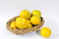 Many oranges in rattan basket. Stock Photos