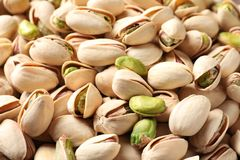 Many organic pistachio nuts as background. Closeup royalty free stock photos