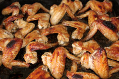 Many oven baked chicken wings Stock Images