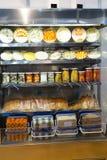 Many packed fish provision on shop shelf Stock Photo