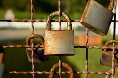 Padlocks. Many padlocks on the bridge railing, traditional marriage symbol royalty free stock photo
