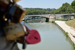 Padlocks on the River. Many padlocks fastened to a lamppost beside the river royalty free stock photography