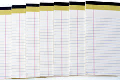 Many pads of paper stacked with blue lines Royalty Free Stock Photos