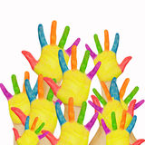 Many painted childrens hands raised up. Stock Photography