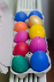 Many painted colorful easter eggs in tray Royalty Free Stock Photo