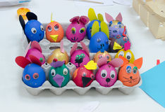Many painted colorful easter eggs in tray Royalty Free Stock Images