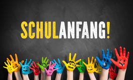 Many painted kids hands with the message 'back to school!' (in German) on a blackboard Stock Photos