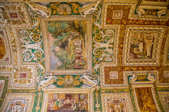 Many Paintings on Curved Vatican Ceiling. Painted ceiling on celing of Vatican museum Royalty Free Stock Photography