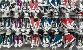 Many pair of sneakers in a store. Stock Image