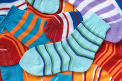Many pairs of child's striped socks. For backgrounds or textures Royalty Free Stock Images