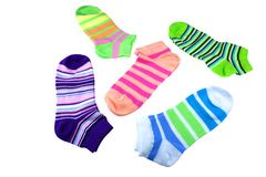 Many Pairs Colorful Striped Socks Isolated On White. Many Pairs of Colorful Striped Socks Isolated On White Background Stock Photos