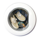 Many pairs of dirty sneakers in the washing machine. Many pairs of dirty sneakers in the washing machine Royalty Free Stock Image