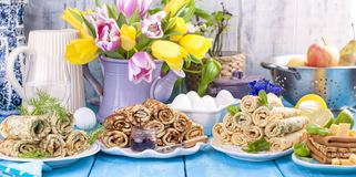 Many pancakes with different fillings and flavors. Delicious traditional food in the spring. Homemade baking. Flowers and. Breakfast. Copy space royalty free stock photo