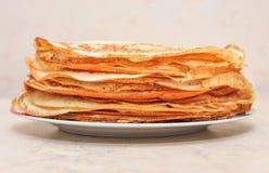 Many pancakes on the plate closeup. Stock Photos
