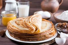 Stack of crepes or pancakes for Maslenitsa. Many pancakes on a wooden background. Traditional Ukrainian or Russian pancakes. Shrovetide Maslenitsa stock photography