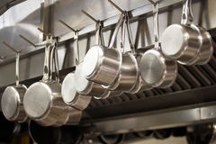 Many pans hanging in a kitchen Royalty Free Stock Photography