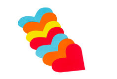 Many paper colored heart shapes Stock Images