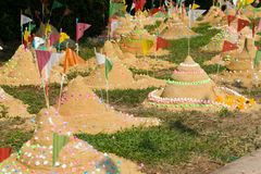 Songkran Festival in Thailand. Many of paper flag put in a heap of sand to celebrate a temple Songkran Festival in Thailand Stock Image