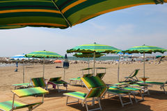 Many parasols and deck chairs on the beach resort Royalty Free Stock Image